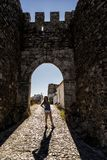 The ancient medieval castle of Evoramonte, Portugal. A woman tourist stands in Evoramonte Castle, a beautiful historic medieval fortress in Portugal royalty free stock photo