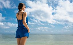 Woman Tourist at the sea looking to horizon Stock Images
