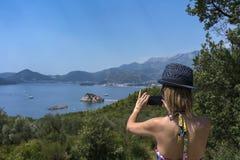 Woman tourist takes pictures Royalty Free Stock Photos