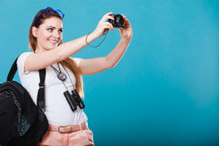 Woman tourist taking photo with camera Stock Photography
