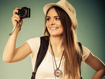 Woman tourist taking photo with camera Stock Images