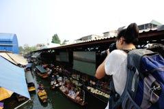 Woman tourist taking photo Stock Photography