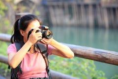 Woman tourist taking photo Stock Images