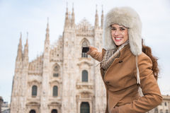 Woman tourist taking photos of Duomo while sightseeing Milan Royalty Free Stock Photography