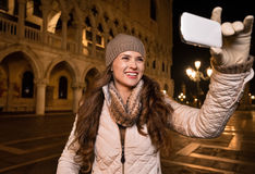 Woman tourist taking photos on St. Marks Square, Venice Royalty Free Stock Photo