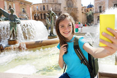 Woman tourist taking selfie pictures on Europe travel. Happy candid tourist on Valencia, Spain. Travel and tourism concept Royalty Free Stock Image