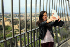 Woman tourist taking selfie from the top of the San Pietro Dome Royalty Free Stock Photo