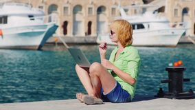 Woman tourist talking on video chat using a laptop.  stock video footage