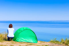 Woman and tourist tent in nature area. Stock Images