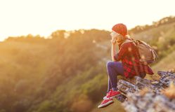 Woman tourist at top of mountain at sunset outdoors during  hike Stock Images