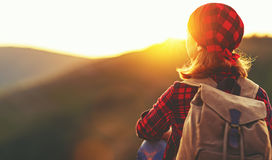 Woman tourist at top of mountain at sunset outdoors during  hike Royalty Free Stock Image