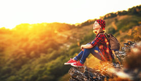 Woman tourist at top of mountain at sunset outdoors during  hike Stock Photos