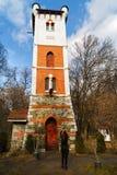 woman tourist traveling through Romania. Fire tower Royalty Free Stock Photos