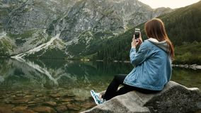 Woman tourist use mobile phone, take photo or record video of landscape for traveler blog stock video