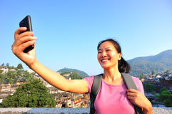 Woman tourist use smart phone at fenghuang ancient Stock Photos