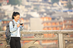 Woman tourist use smart phone Royalty Free Stock Images