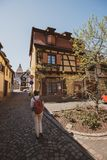 Woman tourist visiting Alsace village street building sightseeing royalty free stock photos