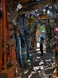 Woman Tourist Visiting the Cathedral of Junk in Austin Texas royalty free stock photography