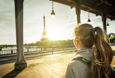 Woman tourist in front of the Eiffel Tower in Paris. Woman tourist walking  in front of the Eiffel Tower in Paris, France Stock Images