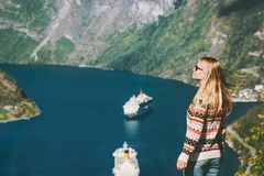 Woman tourist walking over Geiranger fjord in Norway Stock Photo