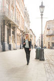 Woman tourist walking on the street. In old city Stock Photos