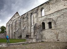 The woman the tourist walks about ruined St. Brigitta convent  1436 year  in Pirita region, Tallinn, Estonia Stock Photos