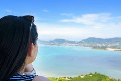 Woman tourist watching the ocean in Phuket, Thailand Stock Photo