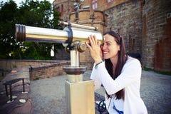 Woman tourist watching at telescope Stock Image