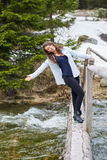Woman tourist on a wooden bridge Royalty Free Stock Photography
