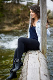 Woman tourist on a wooden bridge Stock Photo
