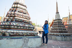 Woman tourists in the temple and pagoda Royalty Free Stock Images