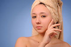Woman with a towel Royalty Free Stock Image
