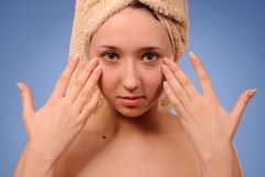 Woman with a towel Royalty Free Stock Photos