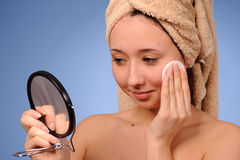 Woman with a towel Stock Photography