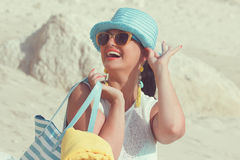 Woman with towel bag on the sandy beach Stock Photos