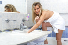 Woman with towel in bathroom Royalty Free Stock Photo