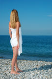 Woman in a towel on a beach Stock Photography