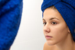 Woman with a towel Stock Images