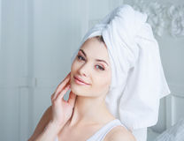 Woman with towel Royalty Free Stock Image