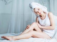 Woman with towel Stock Photos
