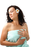 Woman in towel with camomile flower Royalty Free Stock Images