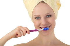 Woman in  towel cleans teeth, toothbrush Royalty Free Stock Image