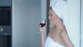 Woman in towel drinking wine Royalty Free Stock Photo