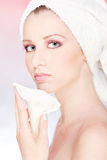 Woman with towel gently holding flower Royalty Free Stock Images