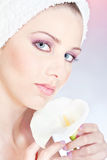 Woman with towel gently holding flower Royalty Free Stock Photography