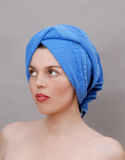 Woman with towel on head. Isolated Stock Photo
