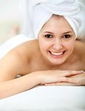 Woman with a towel on her head Stock Photo