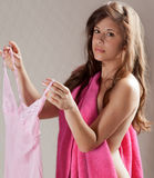 Woman in Towel Holding Lingerie Stock Photo