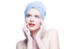 Woman with towel looking up Royalty Free Stock Image