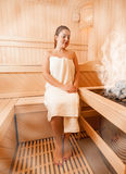 Woman in towel relaxing at steamed finnish sauna Stock Image